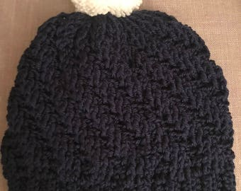 Dark blue slouchy crocheted beanie with white Pom Pom