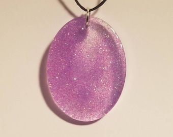 Oval purple sparkling pendant. Epoxy resin pendant, translucent with glitter