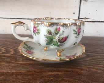 Vintage 3 footed teacup and saucer