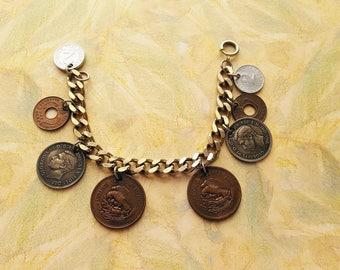 "Vintage Foreign Coin Charm bracelet,Silver tone,7.5"" long,8 charms,3/8"" thick bracelet"
