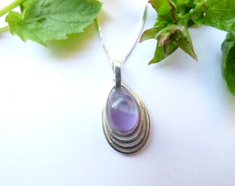 Amethyst Pendant. Sterling Silver Pendant set with a Brazilian Amethyst Cabochon.