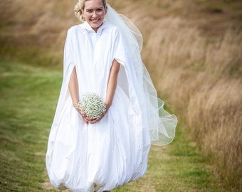 A waterproof bridal cloak to protect from rain, puddles and mud