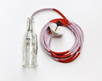 hand knitted cable with a coke bottle