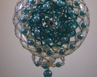 009. Beaded Ornament Cover