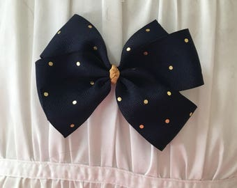 Navy blue with gold polka-dots