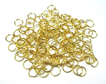 50 7mm color gold plated jump rings