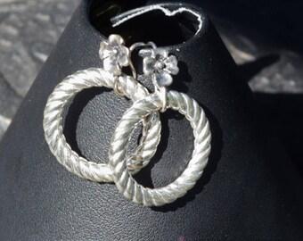 Silver earrings on decorative earwires
