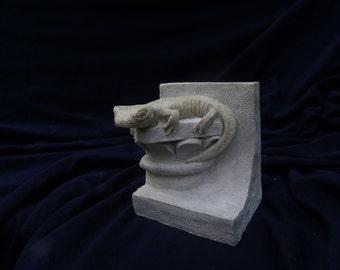 The salamander, reconstituted stone figure.