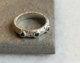 Encrusted ring with green onyx gemstones