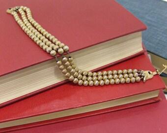 Vintage Crown Trifari Gold Tone Bead Triple Strand Bracelet with Tulip Clasp