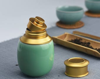 Elegant Ceramic Tea Leaf Storage Bottle with Tea Leaf Spoon and Fabric Pouch
