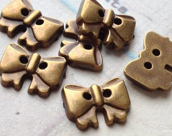 11 x 14 mm Metallic Bronze Acrylic Butterfly Bow Charm Button (.mh)