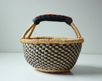 Vintage African woven basket with leather handle