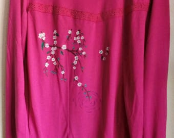 Women's clothing. Fuchsia long sleeve T-shirt with pleated and hand-painted lace with cherry blossoms