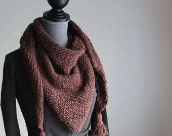 Triangular shawl with tassels made of knitted