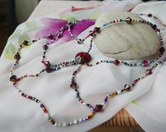 Multi-cloured, multi-tiered beaded necklace