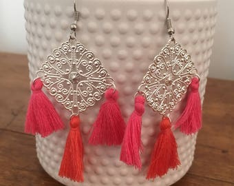 Silver earrings with pink PomPoms and coral