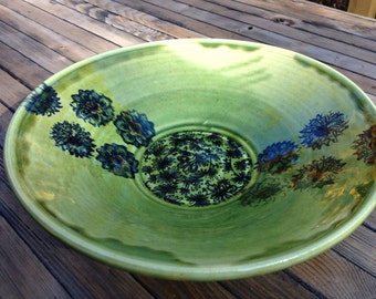 Green pottery serving bowl handmade with cobalt decor made by Ruth Sachs