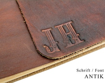 Up to 3 characters - Monogram embossed - We shape your monogram in leather - Personalize your leather book.