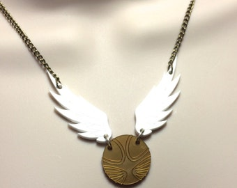 """Harry Potter..laser cut Acrylic winged 'SNITCH"""" necklace"""
