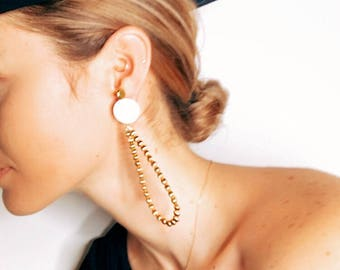 Handmade one of a kind gold plated vintage brass drop hoop earrings and a mother of pearl detail.