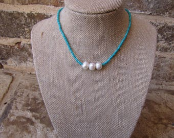 aqua choker with three pearls with a clasp