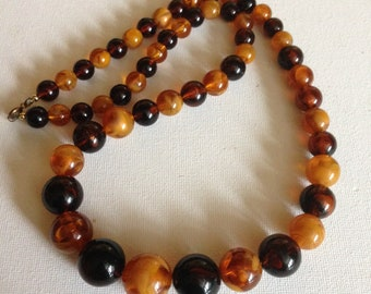 Necklace - vintage marbled orange amber brown round plastic beads long necklace chunky