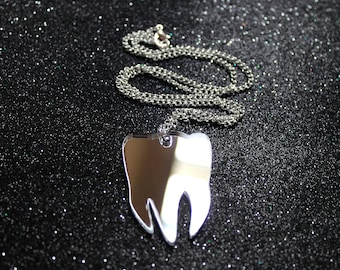 Silver mirror tooth pendant on silver chain necklace