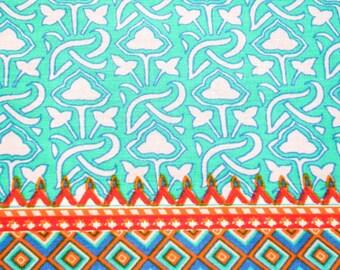 Cotton aqua blue hand block print with colorful contrast border.