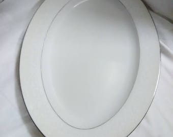 Vintage patter. Oval white with silver trim.