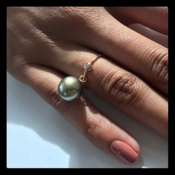 The Tina Ringthis ring is available in rose, white and yellow gold. The pearl measures 10.5-11.5 mm and the diamond weight is.03ct.
