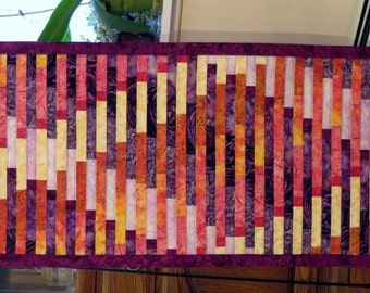 Quilted Interweave Wall Hanging batik red purple gold