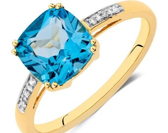 Blue topaz and cz 14k gold ring