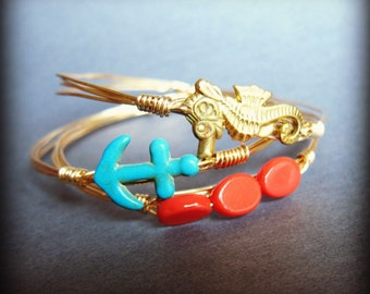 Anchors Away- Gold stackable bangle set, turquoise blue anchor, coral beads, brass seahorse