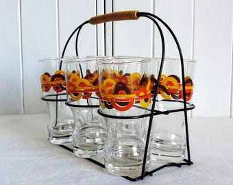 A set of 6, retro vintage French, glasses and metal rack, carrier, holder, yellow, red, and brown motifs on clear glass