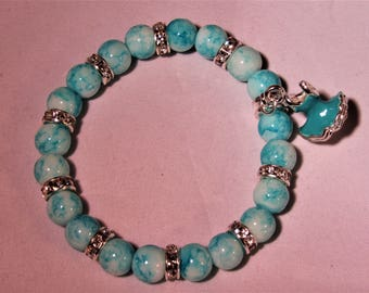 Blue and White glass Beads with a Blue Ballerina Dress Charm Bracelet