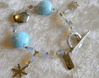 SALE Light Blue w/ White Snowflakes Lampwork & Charms, Swarovski Crystals, Sterling Silver Joy Charm  SS Hammered Toggle Christmas Winter