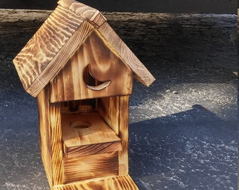 Outhouse squirrel feeder