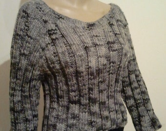 Knitted sweater made of pure hand dyed wool in grey