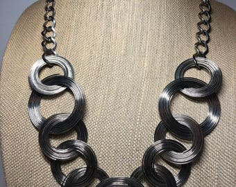 Silver tone wire coil necklace