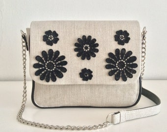 Linen clutch with applied flowers embroidery