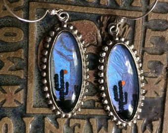 Butterfly wing earrings with desert sunset scene, cactus and yellow sun