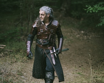 Witcher Gambeson - Geralt Cosplay Costume. Long sleeved black witcher gambeson with leather fastening for cosplay and other