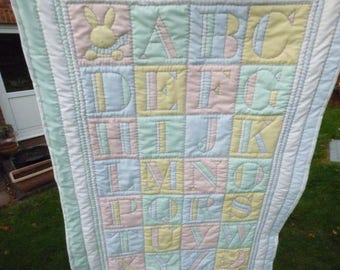 Baby/cot/crib quilt, playmat, wholecloth quilt alphabet theme. Pastel colours. Handquilted. Baby gift, baby shower gift.  108 x 70 cm.