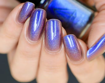 Cosmic Confetti - a purple/blue/red multichrome holographic UK handmade indie nail polish