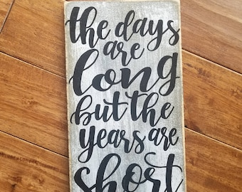 The Days Are Long, But The Years Are Short Sign