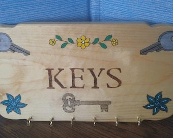 "Wood Burned  ""Keys"" holder Wall Sign, 6 holders,  12.5in x 7in.  25.00"