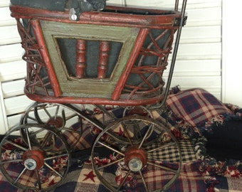 Antique Victorian miniature baby buggy. 1900' s