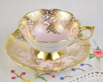 Royal Stafford light pink cup and saucer, richly gilded