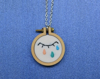 Embroidered necklace of eye with coloured tears